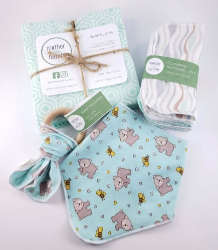 Baby items including burp cloths, dribble bib, teether, and cloth wipes